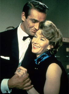 Sean Connery and Lois Maxwell as James Bond and Miss Moneypenny