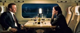 Bond and Vesper have dinner on a train